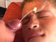 Twink catching big cumload on face
